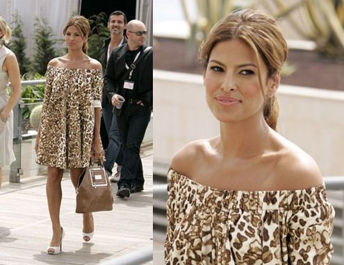 Eva has entered the jungle in her Anna Molinari off-the-shoulder, leopard print frock at the We Own The Night premiere at Cannes. Is it me or does Eva's hair color match her dress and bag - which we speculate is Lanvin? Overall, I like the look, though