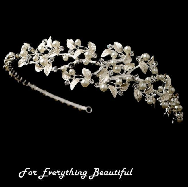http://au.ebid.net/for-sale/silver-rhinestone-ivory-floral-side-wedding-bridal-headband-137067375.htm