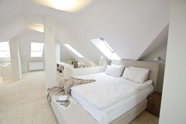 Several White Colored Pillows and White Bed Linen