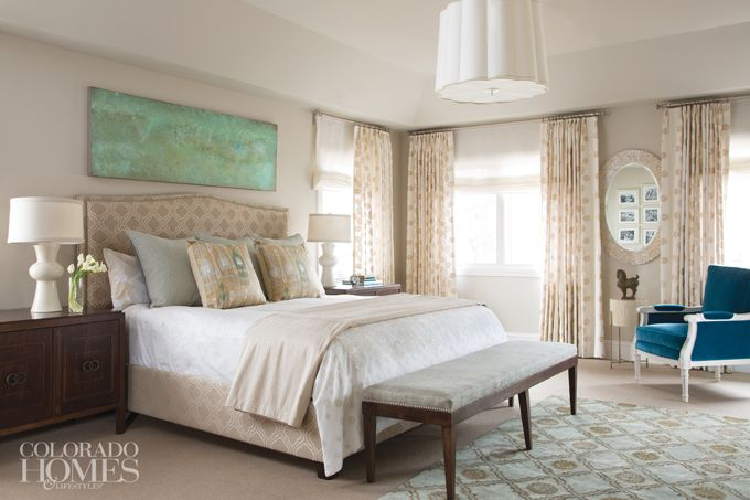 House of Turquoise: Armijo Design Group - soothing master bedroom with upholstered headboard, dark espresso nightstands, a bedroom bench and blue armchair