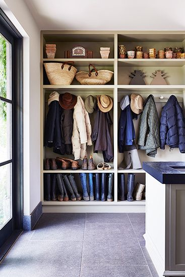 One of the hardest place to organize in a small house. Built-in shelving is the way to go.