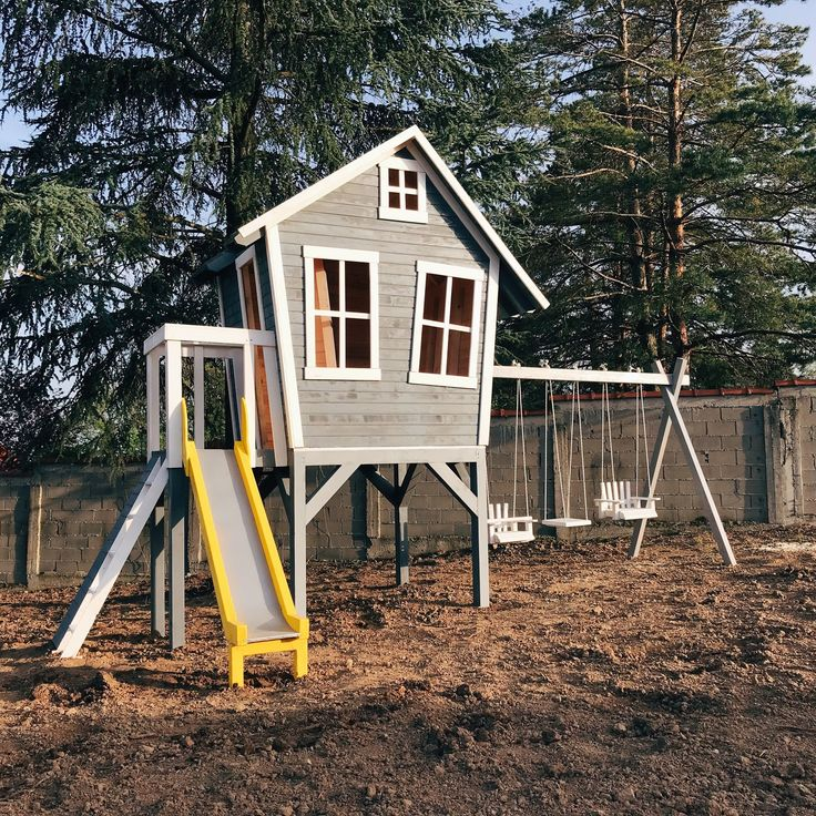 Wooden playhouse with slide and swings. #playground # ...