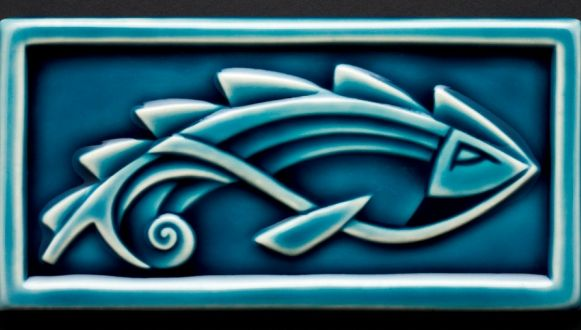 CustomMade by Lynne Meade: Hand cut, hand carved porcelain tile with stylized fishAvailable in Blue, celedon greenCome with rubber feet and hanger on back unless otherwise requested