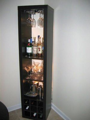 """""""I needed a bar unit to hold some stemware, liquor, and wine. While my new place has tons of vertical space (3 meter high ceilings), I didn't have a lot of floor space in my dining nook. Therefore, I decided a tall, vertical rack would be best. When I was unable to find one that suited me, I decided to make one out of a few parts from Ikea."""