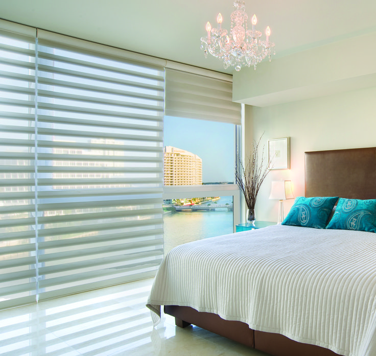 Pirouette shades by Hunter Douglas have a softer look than blinds. They give you the privacy you need in the bedroom and also allow you to see the view.