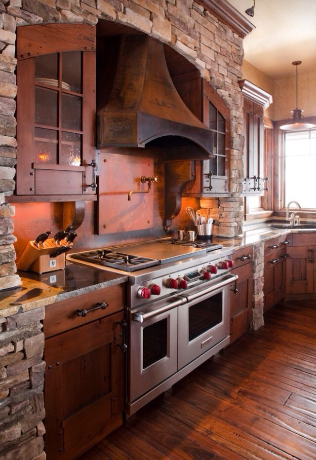 This is good example of stone arch over stove, even has corner sink like our plan!