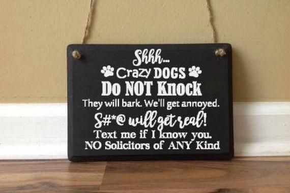 No Soliciting disturb dogs Shit get real sign
