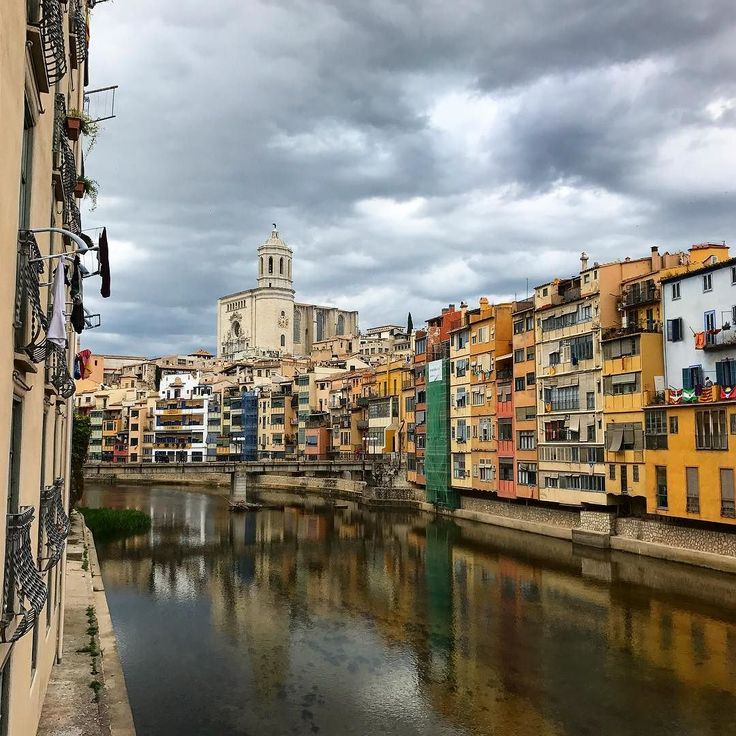 Dramatic clouds above the historic center of Girona in Catalonia Spain. Girona is worth visiting because it's vibrant a lot of cafes restaurants shops narrow streets and a huge university and the old neighborhood scenes from Game of Thrones was shot #danishadventurer