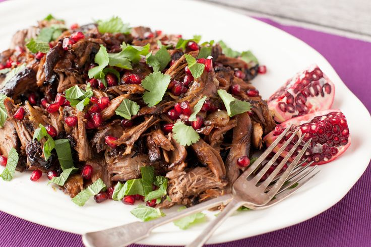 Lamb shoulder marinated overnight in lemon, garlic and spices then slow roasted and glazed with sticky pomegranate reduction. Pulled apart and served with pomegranate seeds and fresh herbs. http://www.ilovecooking.ie/recipe/shredded-slow-roasted-lamb/