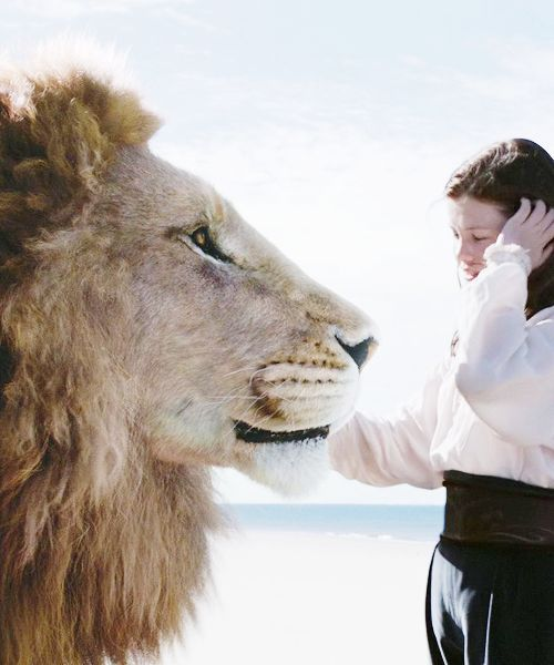 Aslan and Lucy Pevensie