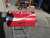 I have a1970's Coca Cola Charcoal Grill and just found it at yardsellr.com for $300. Maybe, I should offer mine for sale. ;-)