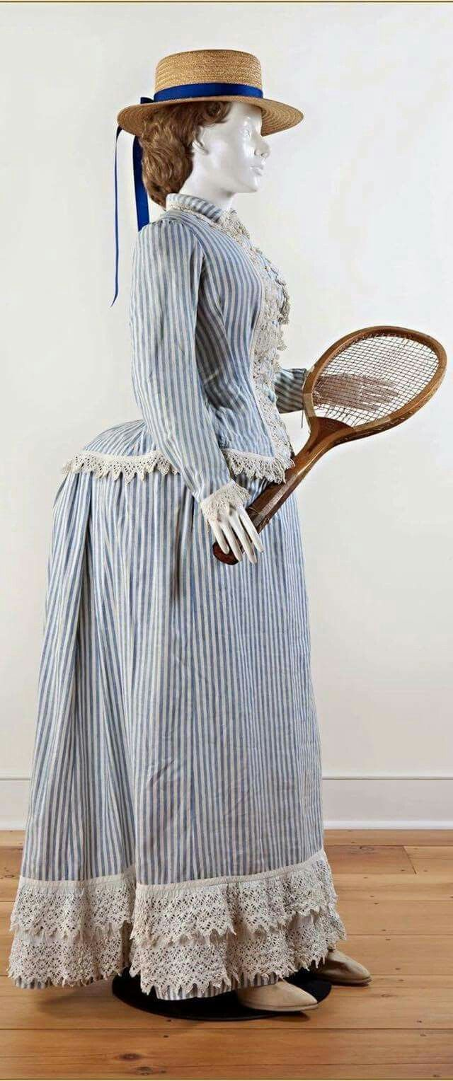 Tennis dress, c. 1885. Two piece blue and white striped cotton, Broderie Anglaise trim on jacket and hemline. Darien Historical Society