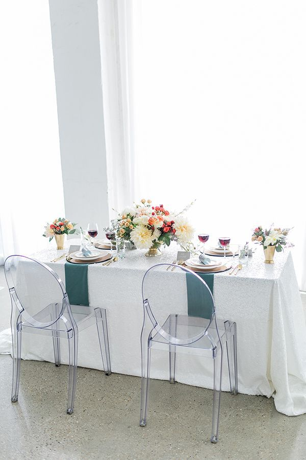 Modern Tablescape With White Sequined Linens And Ghost Chairs | Photo By  Alexis June Weddings |