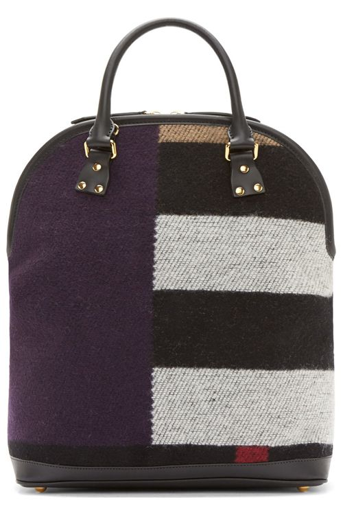 Bloomsbury Blanket Tote by Burberry Prorsum. Structured tote bag in black buffed leather and patchwork wool-cashmere blend. Tones of purple, red, yellow, white, and black at exterior. Twin rolled top handles. Removable adjustable shoulder strap with lanyard clasp closure. Two-way zip closure at main compartment. Zip and patch pockets at bag interior. http://zocko.it/LD2qw