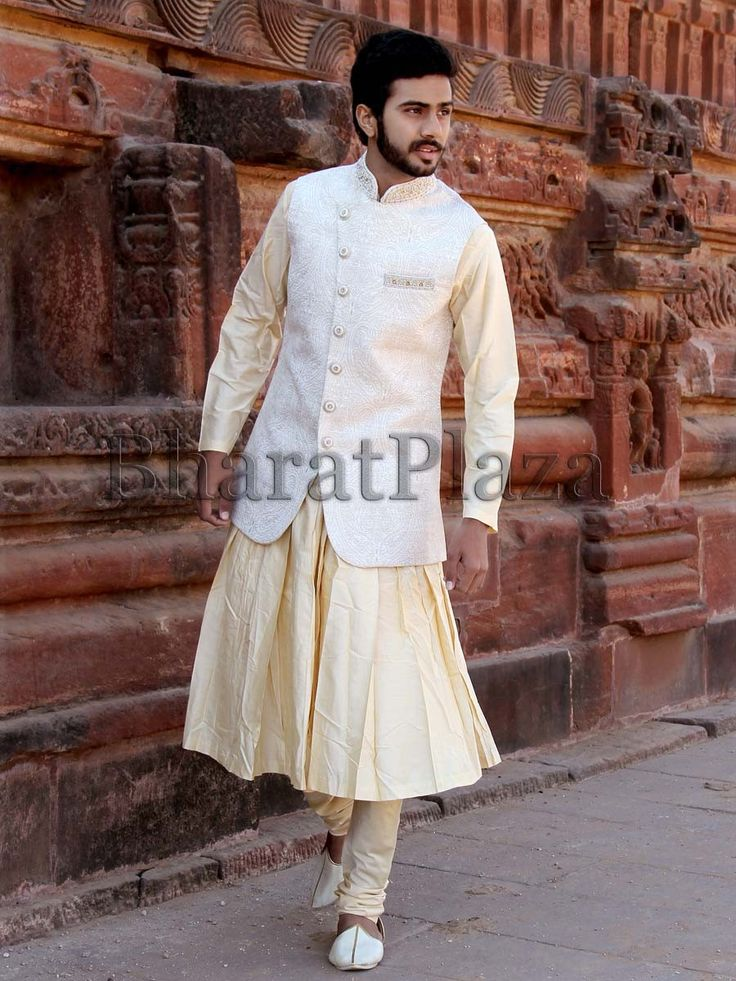 Off white color jodhpuri jacket invented on jacquard designed in angrakha pattern and cutdana, zari work. Item Code: SKHH09LJN http://www.bharatplaza.com/new-arrivals/mens-anarkali.html