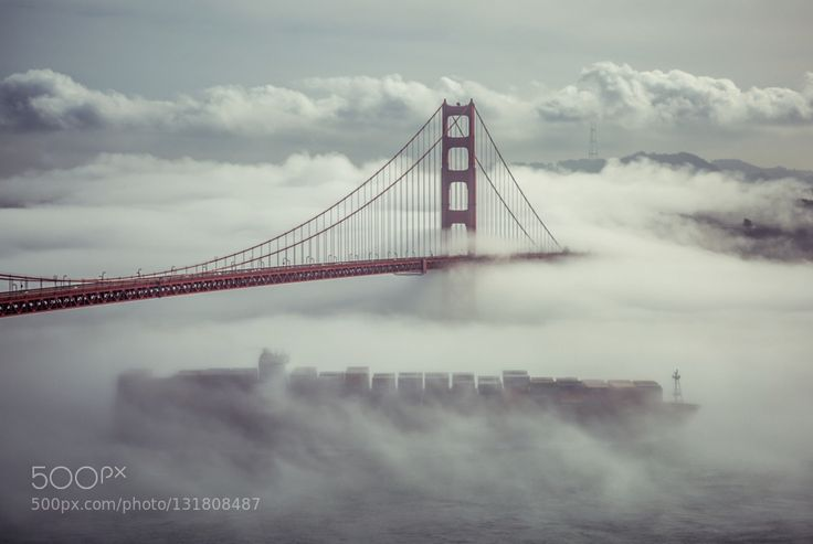 The Ghost Ship #Andrew_Warren - Caught a lucky break as the fog started to lift the bridge became visible rising out of the fog and seemingly out of nowhere the container ship appeared like a ghost..