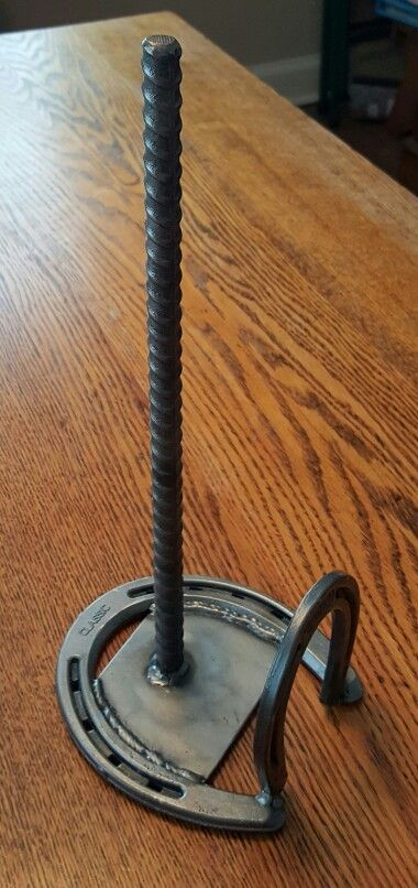 Paper towel holder. Horse shoe, pony shoe, rebar.
