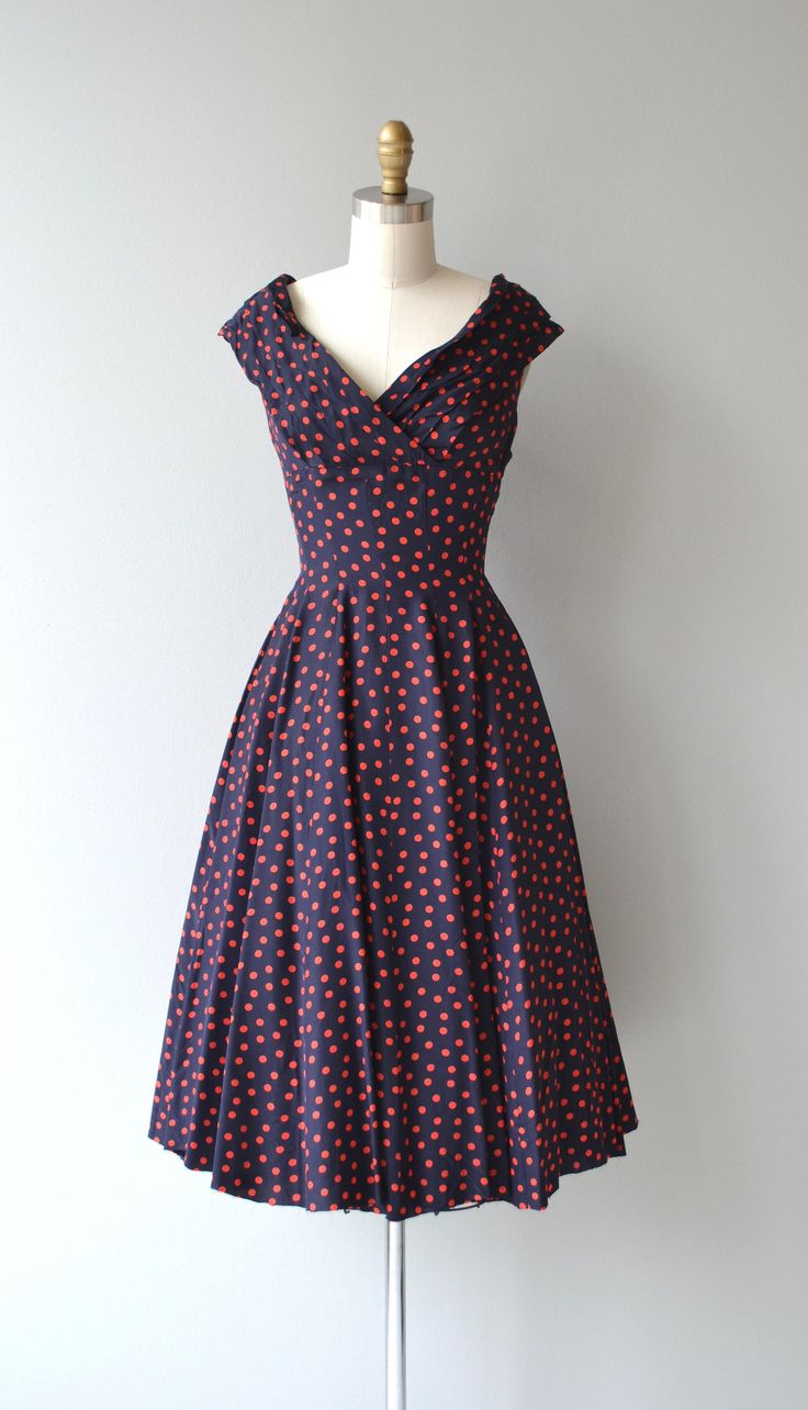 Vintage 1950s Gigi Young navy blue silk dress with red polka dots, pleated open neckline, seamed under bust, princess seaming and metal back zipper. --- M E A S U R E M E N T S ---  fits like: extra small bust: 36 waist: 24 hip: free length: 42 brand/maker: Gigi Young condition: appears to have been pressed strangely so the pleats are not neat, see close up photo, sold as-is. to ensure a good fit, please read the sizing guide: http://www.etsy.com/shop/DearGolden/...