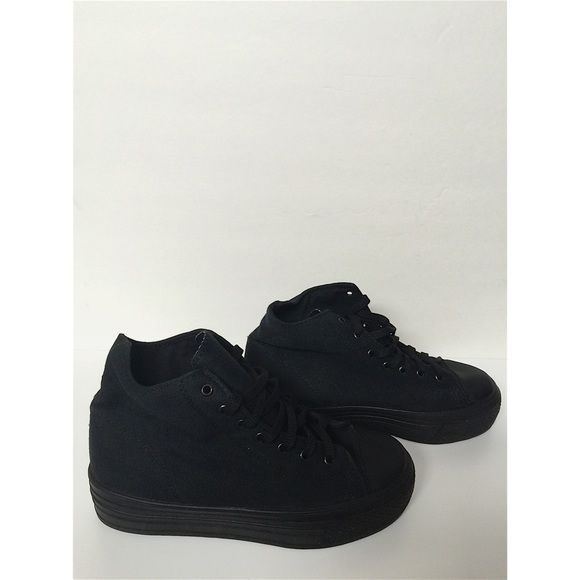 "Black Asos Platform Tennis Shoes All black Asos platform tennis shoes, high tops, canvas material, made in Italy. Worn once, still in great condition! About 1.5"" platform, size 6. ASOS Shoes Platforms"