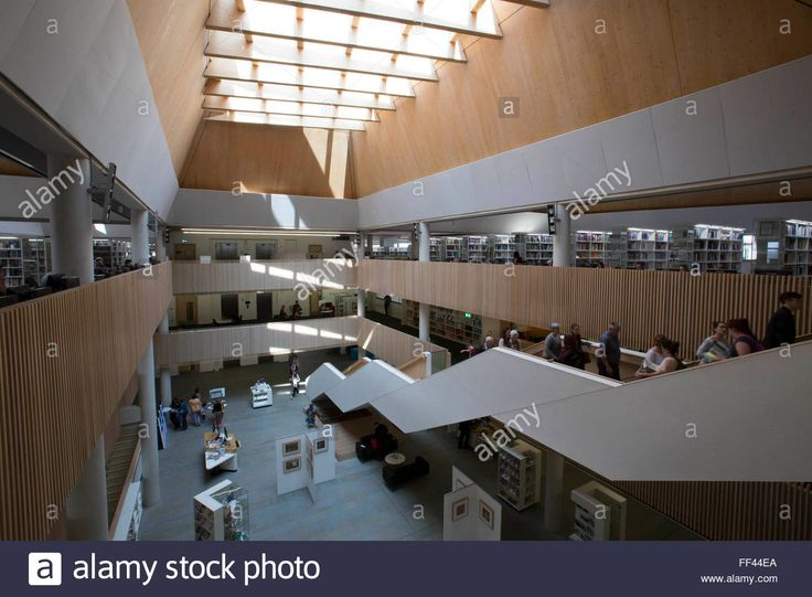 Download this stock image: The Central atrium inside The Hive, Worcester, UK. The first fully integrated university and public library in the UK. It also houses the county archives and archaeology service, the local history centre and local authority hub. The building is low energy. - FF44EA from Alamy's library of millions of high resolution stock photos, illustrations and vectors.