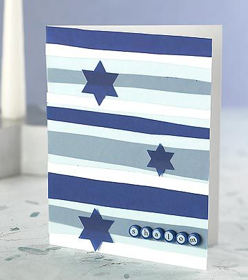 Create a contemporary Hanukkah greeting card with vellum strips and brads.