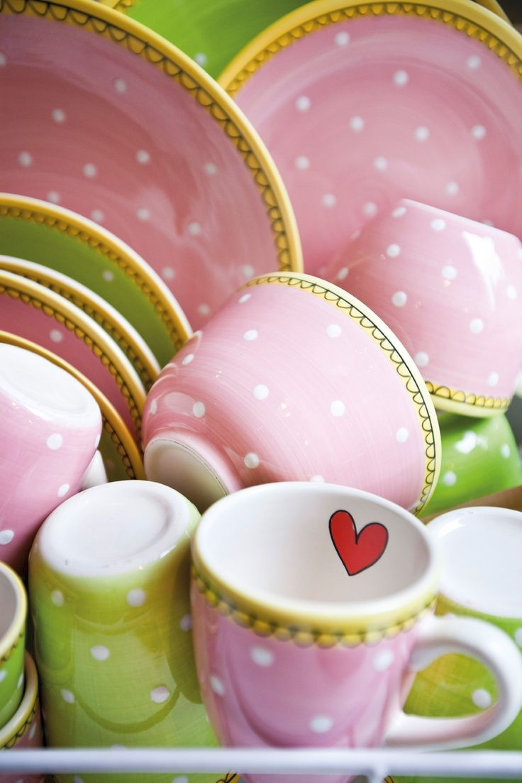 Pink dotted dishes. Love the green and yellow touches.