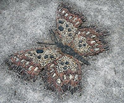 Butterfly Pebbles Mosaic at Gresgarth Hall, Arabella Lennox-Bond Country Home in Lancashire    This is always something I have wanted to try with stones.  I love how this  one is recognizable. Most I have seen are only patterns.  Very awesome.