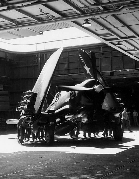 Personnel maneuver an F4U Corsair of Fighter Squadron (VF) 791 on the hangar deck of the carrier Boxer (CV 21) operating off Korea on July 4, 1951, sixty-two years ago today.