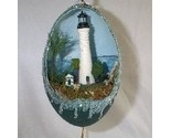 This is a real emu egg decorated with a miniature likeness of Key West Fla lighthouse in a 3-D diorama with an oil-painted seascape in the background.  Hand-painted and hand-decorated by me.