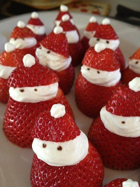 Santa Strawberries:  it's best to have in-season fruit, instead of imported fruits.  You will need:  Strawberries  and Whipped cream (in a nozzled container)  Directions:  Cut off the pointed part of your strawberries  Squirt some whipped cream on the strawberry in place of where you removed the top  Replace the top onto the cream, careful not to push down too hard  Squirt a small dot on top!