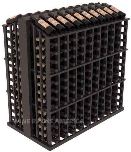 "Wooden 260 Bottle Single Reveal Aisle Wine Cellar Rack Storage Kit in Mahogany with Black Stain + Satin Finish by Wine Racks America®. $827.90. Easy-edge Bottle Holders: Measuring 11/16"" x 11/16"" x 12 5/16"" long - thicker and longer than the competition and your wine bottle labels won't tear because of the smooth, hand-sanded edges where the bottles lay.. Standard 3 3/4"" bottle cubicles: Fits most of the 750 ml bottles on the market. This includes the Oregon Pinot bottles, s..."