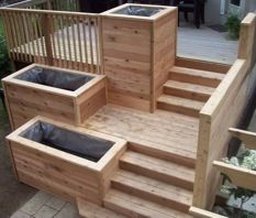 Multi-level deck with flower beds. Yesss.