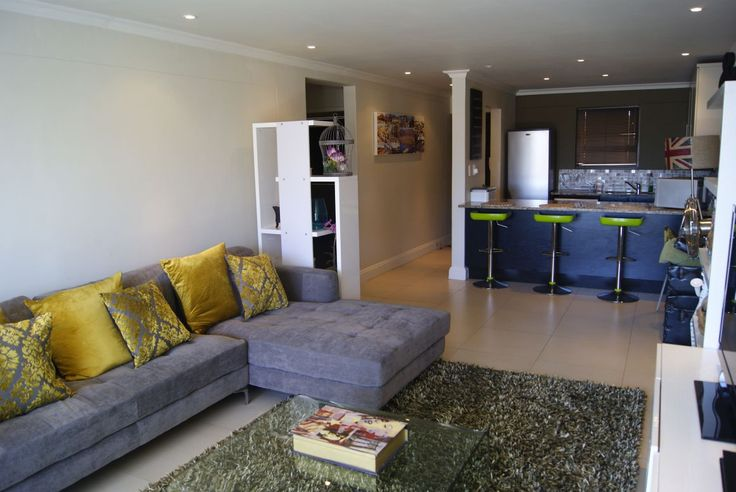 Spacious Lounge with L-shape Sofa and Flat Screen TV