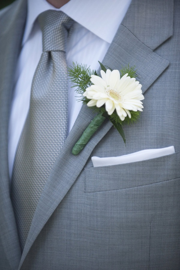 classy gray suit with simple flower...I think I prefer gray suits for a wedding over black.
