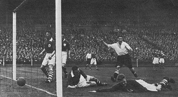 27th April 1946. Charlton Athletic left back Bert Turner puts the ball past his own goalkeeper Sam Bartram to give Derby County the lead three minutes from time in the FA Cup Final, at Wembley.