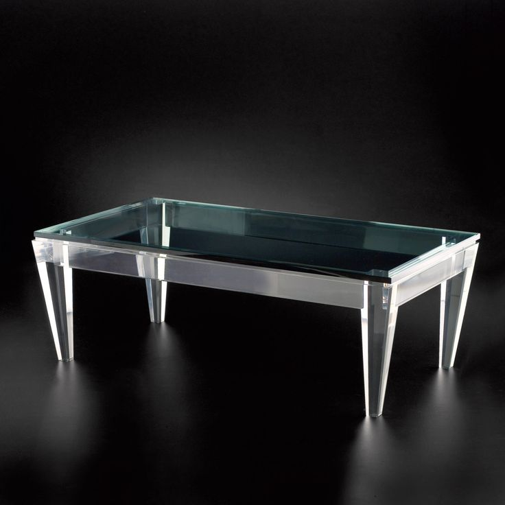 glass table with blue and alloy feet beautiful glass with vast field and suitable to be placed in living room