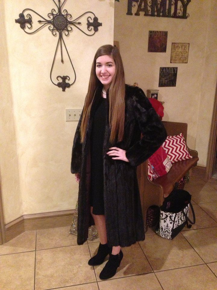 My precious granddaughter modeling her mama's mink coat I'd given her.  I gave her her mama's pearls she wore at her wedding and her grandmother's diamond ring for her birthday at La Baguette in OKC.