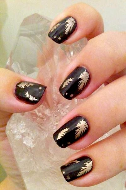 Gold feather nail art on black nails. O Spa Kelowna, En Vogue Gel Nails and Lac Sensation Manicures