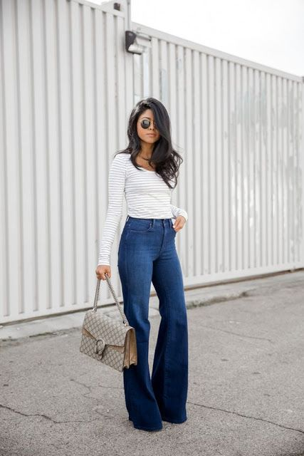 Street style | High waisted flared jeans over striped shirt #women'sfashiontrends