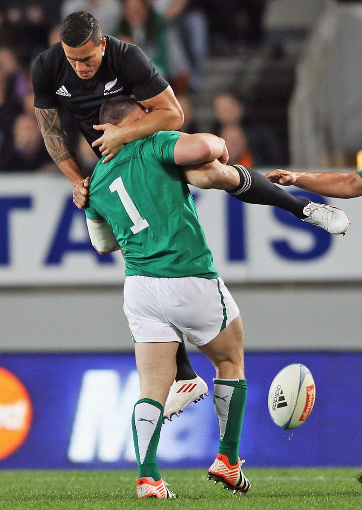 Ireland's Cian Healy tackles New Zealand's Sonny Bill Williams