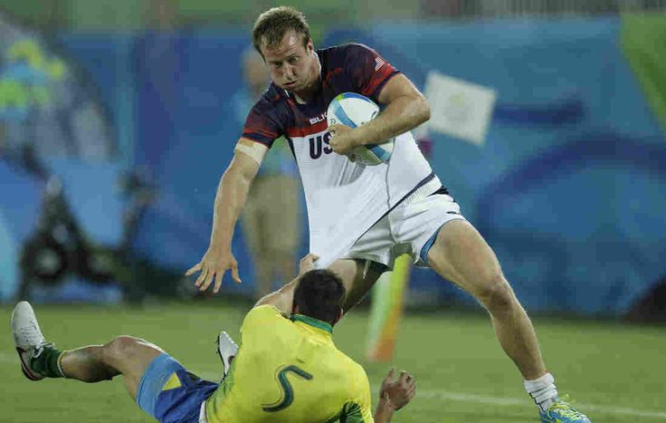 Ben Pinkelman of the U.S. tries to escape Brazil's Stefano Giantorno during a rugby sevens match. The U.S. defeated Brazil, 26-0, after losing to Argentina earlier in the day. Men's rugby returned to the Olympics on Tuesday after a 92-year absence.