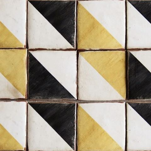 "You can create a striped look like this using three colors of 4"" triangles. Tiles design inspiration"