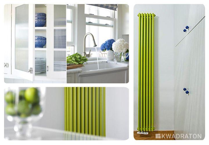 Zielony grzejnik z białą kuchnią i niebieskimi dodatkami.
