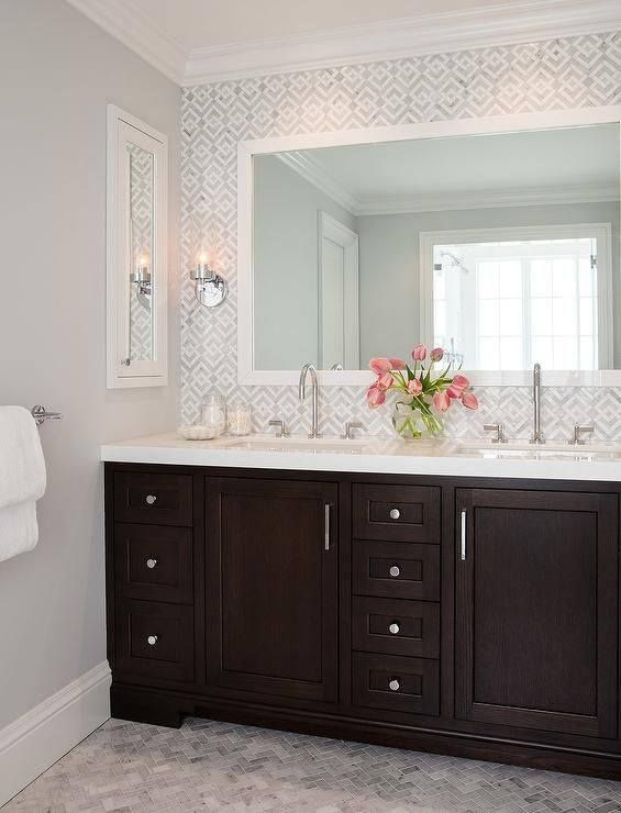 Gallery For Photographers A black and white beveled mirror illuminated by an antique brass uplight sconce lines an ivory Bathroom WallpaperHall BathroomDesign