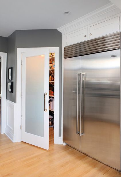 Frosted Glass Pantry Door  This frosted door looks great in this contemporary kitchen and helps hide any mess. The door hardware mimics the refrigerator hardware