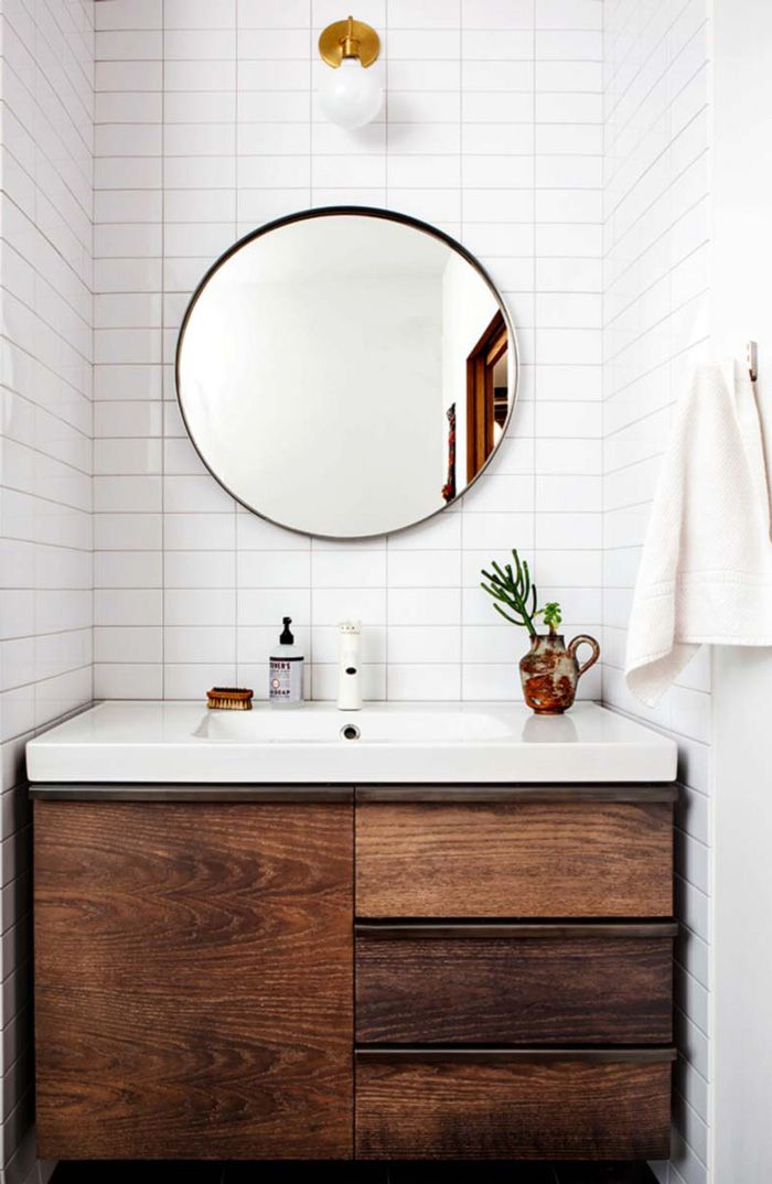 The straight stacked white subway tile go perfectly with this warn cabinet for a minimalist feel.
