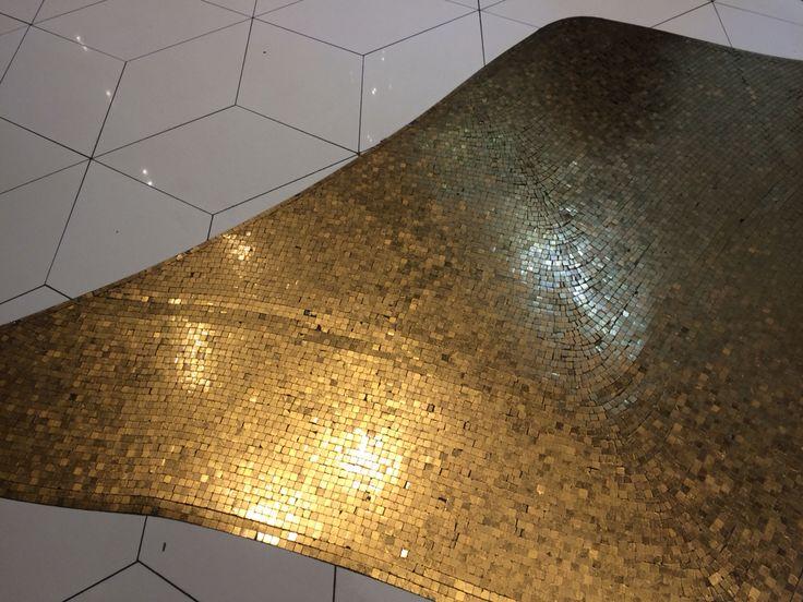 Gold leaf mosaic floor tiles