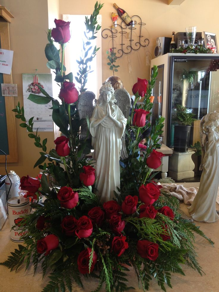 Add your own special rememberance with lovely statuary....red roses add that classic touch