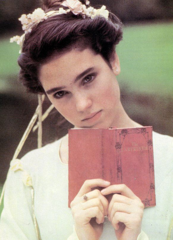 Jennifer Connelly - Labyrinth Reading a book with ribbons in her hair, just how I'd like to spend my time!