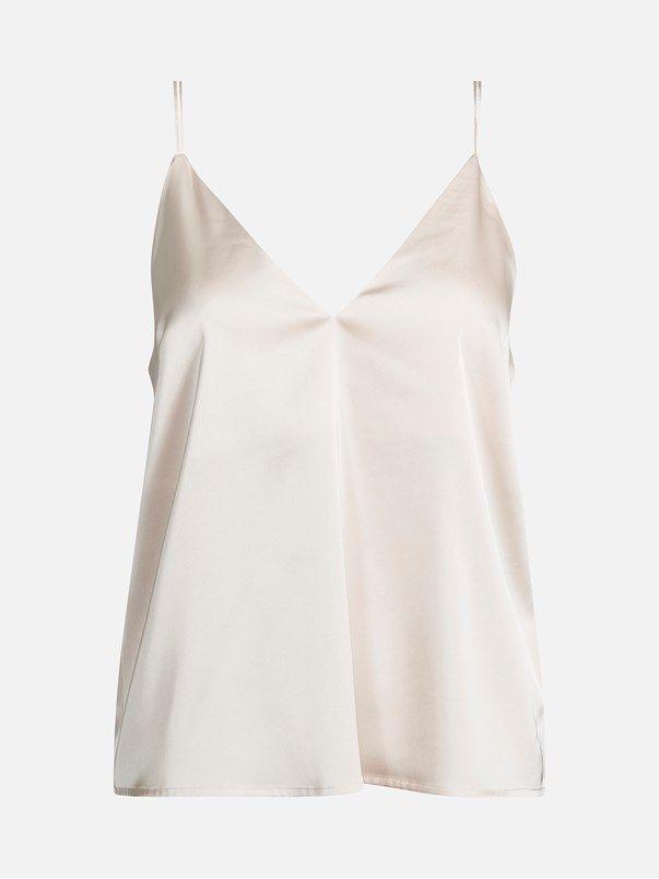 Loose fit satin top. V-neck at front and back. Narrow shoulder straps. Lining at top part. Vaalea pinkki